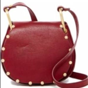 🆕 CYNTHIA ROWLEY red studded saddle bag- rt $225
